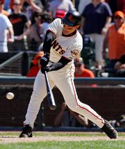 San Francisco's Omar Vizquel connects on a sacrifice fly in the Giants' game Saturday against the Dodgers. Vizquel ranks third all-time in games played by a shortstop.