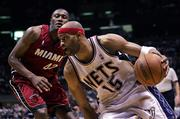 New Jersey's Vince Carter (15) dribbles past Miami's James Posey during the fourth quarter. The Heat beat the Nets, 102-92, Sunday in East Rutherford, N.J., to take a 3-1 lead in the series.