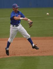 Kansas University shortstop Ritchie Price hurls the ball to first base. Price and the Jayhawks fell to the Northern Colorado Bears, 7-4, Sunday at Hoglund Ballpark.