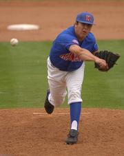 KU pitcher Paul Smyth lets loose a pitch. The Jayhawks lost their second straight game to Northern Colorado, 7-4, Sunday at Hoglund Ballpark