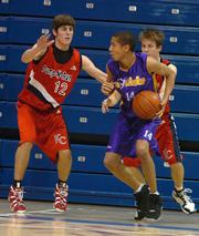 Ft. Sooy No Limit's Verdell Jones, center, attempts to elude K.C. Pump N Run's Conner Teahan, left. Jones and Teahan both list Kansas University as a possible college choice.
