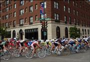 Cyclists in the Men's Division I Criterium take a turn past The Eldridge Hotel at Seventh and Massachusetts streets. The event was part of the 2006 Collegiate Road National Championships.