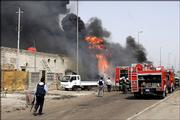 Iraqi firefighters extinguish a fire following a roadside bomb that hit an oil tank, sending a large plume of black smoke up over central Baghdad, Monday, May 15, 2006. Four Iraqis were killed and five wounded in two attacks.