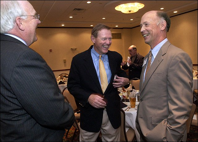 Alan Mulally, president and chief executive officer of Boeing Commercial Airplanes, center, laughs with M-Pact Inc. President Jim Martin, left, and Douglas County Bank President Ted Haggart before the start of the Lawrence Chamber of Commerce's Spring Luncheon Series. Mulally was the keynote speaker at the luncheon Tuesday at SpringHill Suites by Marriott.