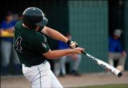 Free State High's Brett Lisher connects against Leavenworth in the Firebirds' regional opener. FSHS beat the Pioneers, 13-3, and Washburn Rural, 15-0, to win its regional Wednesday at Free State and earn a trip to state.