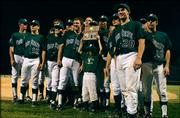The Free State High School baseball team poses for the cameras after winning the regional tournament championship. FSHS defeated Washburn Rural 15-0 in the final game at Free State High School.