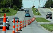 Southbound vehicles on Kasold Drive merge right during afternoon traffic. Heavy construction will begin soon on Kasold Drive between Bob Billings Parkway and 22nd Street.