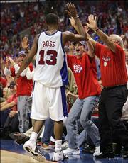 The Clippers' Quinton Ross celebrates with fans after hitting a shot in the waning seconds of the second quarter. The Clippers beat the Suns, 118-106, Thursday in Los Angeles to even their series at three game apiece.