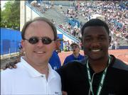 Michael Stuart, owner of Stuart Chiropractic Health Center, 1420 Kasold Drive, visits with sprinter Justin Gatlin before the Gold Zone II competition at the Kansas Relays at Memorial Stadium. Gatlin, who this month tied the world record in the 100-meter run, received treatment from Stuart during the Relays.