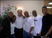 A number of track athletes stopped by Michael Stuart's office during the Kansas Relays in April. From left are Kaaron Conwright, Angela Williams, Stuart, Maurice Greene, Leonard Scott and Kenny Ferguson.