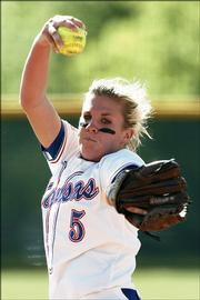 Kansas University's Kassie Humphreys delivers a pitch during an NCAA regional game against Brigham Young University. The KU right-hander finished with a shutout Thursday as the Jayhawks earned a 3-0 victory at Gail Miller Field in Provo, Utah.