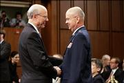 Senate Intelligence Committee Chairman Sen. Pat Roberts, R-Kan., left, greets CIA nominee Air Force Gen. Michael Hayden on Capitol Hill. Hayden's confirmation hearing before the Senate Intelligence Committee opened Thursday.