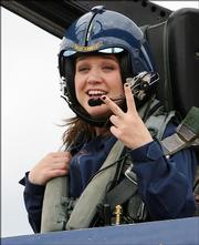 """American Idol"" winner Kelly Clarkson holds up two fingers while talking about getting airsick twice in the cockpit during her flight with one of the Blue Angels, the U.S. Navy&squot;s flight team, in this May 10 photo. Clarkson has followed her ""Idol"" win with a successful singing career, as have the other winners - and some of the losers."