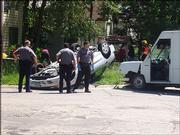 Police work at an accident site Friday afternoon in east Lawrence where a car flipped onto its top after being struck by a delivery van at 13th and Connecticut streets. The car's passengers received only minor injuries, according to a Lawrence police spokeswoman.