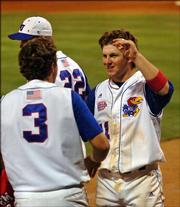 Kansas University's Ryne Price celebrates with his teammates after hitting the go-ahead home run against Texas A&M. The Jayhawks topped the Aggies, 2-1, Friday at Hoglund Ballpark.