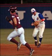 Texas A&M's Blake Stouffer runs to second base as Kansas' Ryne Price prepares to throw to first base.