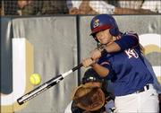 KU's Heather Stanley hits against BYU. The Jayhawks defeated the Cougars, 2-1, after losing to Washington, 6-0, earlier Friday.