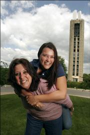 Pat Argueta and her daughter, Toni, are both graduating from Kansas University today. They horsed around on the lawn in front of the Campanile last week.