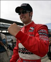 Sam Hornish celebrates after winning the pole for the Indianapolis 500. Hornish posted the top average speed of 228.985 on Saturday in Indianapolis.