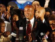 New Orleans Mayor Ray Nagin celebrates his re-election with campaign supporters. Nagin claimed victory over challenger Lt. Gov. Mitch Landrieu in Saturday's election. While the vote was split largely along racial lines, Nagin was able to get enough of a crossover in predominantly white districts to make the difference. He also won a slim majority of votes cast by evacuees scattered across the country.