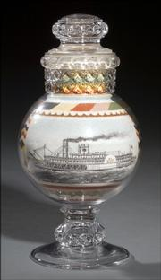 Natural-colored sand was packed into this 8-inch-high decorative glass jar to form the picture of a side-wheel steamboat. The back of the bottle shows a rose and other flowers. It was offered this year at Cowan's Auctions in Cincinnati for more than $6,000.
