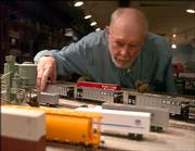 Bob Adams is an enthusiast of real and model trains. The retired Kansas University professor has enjoyed several rides on the Amtrak route that travels through Lawrence. His basement is a landscaped model train extravaganza that crosses from room to room.