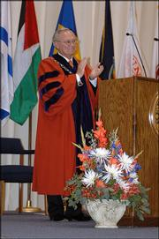 Baker University President Dan Lambert presides over his final graduation ceremony at the Baldwin school. Lambert, who is leaving the university after 19 years, encouraged the graduates to value their education and their instructors during Sunday's ceremony.