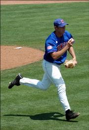 KU pitcher Ricky Fairchild fields a ground ball and prepares to toss it to first base for an out. Fairchild and the Jayhawks earned the No. 6 seed in the Big 12 tournament and will face No. 3 Oklahoma on Wednesday.