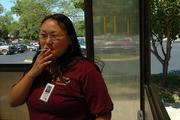 Lawrence Memorial Hospital food and nutrition department employee Juanita Waskey, Lawrence, has a cigarette outside the hospital in a designated smoking hut. In September, the hospital will prohibit smoking anywhere on the 325 Maine campus and its other properties.