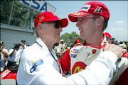 Driver Sebastien Bourdais, right, embraces team owner Paul Newman after Bourdais won Mexico's Grand Prix of Monterrey. Bourdais won Sunday in Monterrey, Mexico.