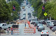 In a view from atop City Hall, southbound traffic is confined to one lane between Eighth and Ninth streets and again between 10th and 11th streets.  Construction crews began work Monday on the downtown waterline project, which is expected to last until mid-September.