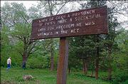 """INformational signs are posted for visitors at the Battle of Black Jack site. A Lawrence-led coalition is seeking National Heritage Area status for a 38-county area in Kansas and Missouri, and the Black Jack site would be a """"crown jewel"""" for such a designation, says Judy Billings, a committee leader."""
