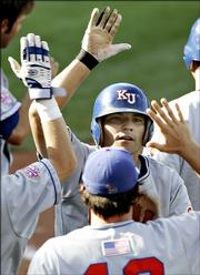 Kansas University's Matt Baty celebrates his fourth-inning home run against Oklahoma. KU beat OU, 7-2, Wednesday in the Big 12 Conference tournament in Oklahoma City.