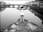 Corinne Fetter embraces the view of the Ponte Vecchio, in Florence, Italy, during her study abroad trip in spring 2005 through Kansas University. The KU graduate says the trip was a life-changing experience.