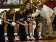 Lawrence High School players, from left, Tyron Mumford, Matt Duncan, and John Novotny were familiar with Coach Chris Davis' in-game instructions last season. Now, Davis is offering instruction in basketball fundamentals through his SkillsChamp Sports Camp, to be offered this year nationwide.