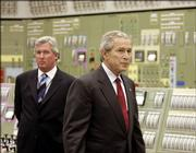 President Bush visits the control room of the Limerick Generating Station with Chris Cane, left, president and chief nuclear officer of Exelon, during a tour of the facility Wednesday in Limerick, Pa.