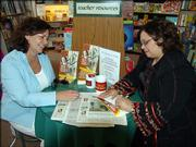"Kansas University alumna Mi-Ling Stone Poole, right, signs a copy of her book, ""When You Want the Truth About Decorating"" for a reader at Best of Books in Edmond, Okla. She gives decorating advice through a newspaper column and regular radio appearances in Oklahoma City."