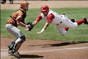 Nebraska's Ryan Wehrle leaps past Texas' Preston Clark to score in the second inning of the Huskers' 6-5 victory over Texas. The victory Saturday in Oklahoma City allowed NU to advance to today's Big 12 tournament championship game.