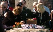 From left, Lucas Frantz's mother, Lorrie VanDruff, and his stepfather, Tim VanDruff, and Frantz's wife, Kelly Frantz, mourn Frantz during his funeral Oct. 27, 2005, in Tonganoxie. Frantz, a corporal in the U.S. Army, was killed while serving in Iraq.