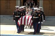 The casket of Lance Cpl. Christopher Brandon Wasser, of Ottawa, is carried from Ottawa University Chapel during memorial services April 17, 2004. Nearly 1,000 people attended the service to pay tribute to Wasser, who was killed April 8, 2004, by a roadside bomb in Iraq.