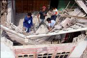 Residents remove rubble in a search for survivors in a damaged house Saturday in Bantul, Indo-nesia. An earthquake flattened buildings, killing more than 3,700 people and injuring thousands more in the country's worst disaster since the 2004 tsunami.