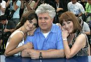"Spanish director Pedro Almodovar, center, poses with spanish actresses Penelope Cruz, left, and Carmen Maura during a photo call Friday for the film ""Volver"" at the 59th International film festival in Cannes, southern France. ""Volver"" is among the prospects for the Palme d'Or, the key prize at the 12-day festival."