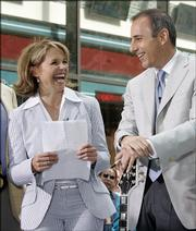 "Katie Couric and Matt Lauer, co-hosts of the NBC ""Today"" program, enjoy a laugh during a segment of the show taped Friday in New York&squot;s Rockefeller Center. Wednesday is Couric&squot;s last day as ""Today"" co-host."