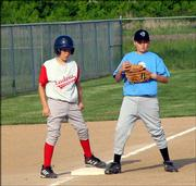 The Sidewinders third baseman keeps the Cardinals runner in check by keeping his foot on the base May 22 at Youth Sports Inc.