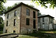 History buffs are hoping to restore the 150-year-old home, left, which was a stop on the Underground Railroad. The home next door would be used as a visitors' center. The project would be part of a proposed Bleeding Kansas National Heritage Area covering 26 counties.