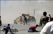 Afghan protesters throw stones at a U.S. military vehicle after a traffic accident Monday in Kabul, Afghanistan. The deadly accident involving U.S. troops sparked a riot in the capital, with gunfire heard near the U.S. Embassy. At least three people died in the accident and a fourth person was reportedly killed by gunfire, police said.