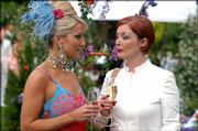 "Zoe Lucker portrays Tanya Turner, left, with Alison Newman as Hazel in a scene from the BBC America series ""Footballers Wive$."" While ABC&squot;s ""Desperate Housewives"" are away for the summer, the glitzy British series about very bad behavior in the soccer world returns for a fourth season."