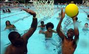 "Young men play a game of ""bucket"" last summer at the Lawrence Outdoor Aquatic Center."