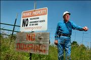Lawrence landowner Rex Youngquist, 86, is in the middle of a dispute with county officials about concrete, waste and debris from the old Kansas River bridge that he says was dumped years ago on his property in North Lawrence.