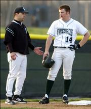Free State High's Brett Lisher speaks with Firebirds coach Mike Hill during a game against Lawrence High. Lisher is one of eight players from this year's Class 6A state championship team who will suit up for the Lawrence Raiders this summer.